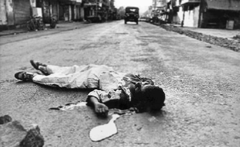 Riot victim on road